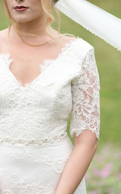 Wedding dress with lace white sleeves.