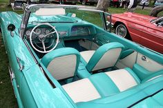 1959 Ford Thunderbird conv't with turquoise & white vinyl interior. Manual windows & no AC.
