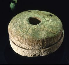 A set of 'quern' stones in a Viking era hand-mill. The grains were poured into the 'eye' of the mill and the stones rotated with a stick. Like the hearth of a house, the mill would have been associated with magical potency.