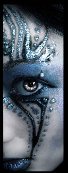Facial art - tattoos, metallic engravings, a form of birthmark?  Hmmm...