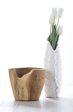 Oberon Small Porcelain Vase A creamy porcelain vase is formed by the scalloped edges of a small, detailed, fluted leaf.