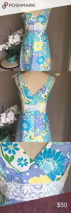 Lilly Pulitzer Linen Sundress size 6 Gorgeous linen sundress in vibrant purple, blue, and yellow floral print fully lined with polyester/cotton blend material. V neck. Tie at shoulders. Zipper back. Lace accents just below bust. Machine washable or dry clean. Smoke free home Lilly Pulitzer Dresses