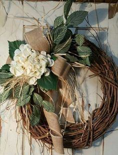 Handmade item Materials: grapevine wreath, glue, wire, wired burlap, realistic fern, realistic greenery Made to order Ships from United States Questions? Contact shop owner Item details BEST SELLER This beautiful burlap bow hydrangea front door greenery wreath is the perfect simple accent for your door or interior. A wired burlap ribbon makes a simple bow. FRONT DOOR WREATH Average Diameter: 22 (tip to tip) This wreath will be created on a grapevine wreath measuring approximately 18 Indoo...
