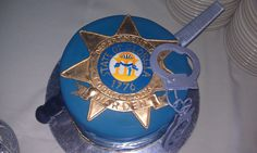 Grooms cake for a warden. Its a badge with handcuffs and a file sticking out of it.   www.contemporarycakery.com