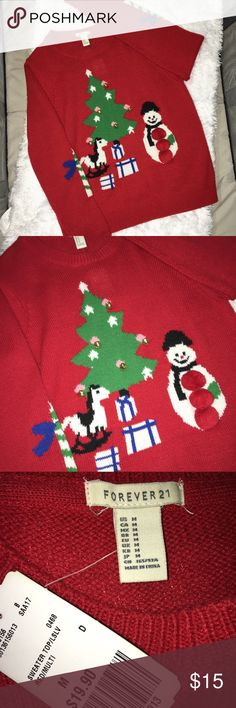 "NWT Forever 21 red ugly Christmas sweater Medium NWT. Forever 21 red cute ""ugly"" Christmas sweater. Size medium. 3D embellishments. Christmas tree with bells and snowman with Pom poms. Candy canes as elbow patches on each sleeve. Thick knit. Perfect for fall parties and holiday events. Bottom hem Hits around waist. #christmas #sweater #holiday #event #party #red #knit #bells #santa #candy ❌no trades ❌ Forever 21 Sweaters"