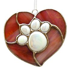 Paw print stained glass heart ornament