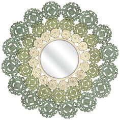 You'll love the intricate details of the McGuire Medallion Mirror. A round mirror is surrounded by wrought iron scrollwork with additional floral elements in so