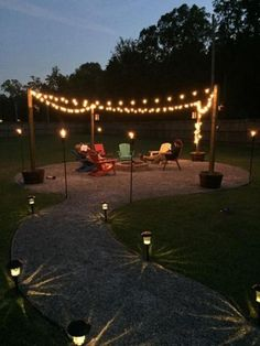 DIY Outdoor fire pit with sweet ambiance effect! This guy uses limestone for the walkway and seating area. I think for my house I would use pavers. Pavers would be more work though. outdoor fire pit DIY Fire Pit and Seating Area Cheap Fire Pit, Diy Fire Pit, Fire Pit Backyard, Backyard Seating, Cozy Backyard, Garden Seating, Deck With Fire Pit, Back Yard Fire Pit, Outdoor Fire Pits
