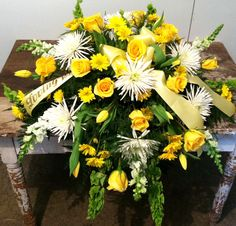 Casket spray of mixed yellow and white fresh flowers. fav flower is yellow roses carnations , daisys,