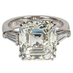Classic Emerald Cut Diamond Platinum Engagement Ring  | From a unique collection of vintage engagement rings at http://www.1stdibs.com/jewelry/rings/engagement-rings/