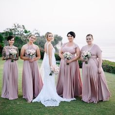 Loving Taylor's gorgeous sunset wedding in Bali  what a stunning bridal party in their Goddess By Nature signature ballgowns in dust me pink colour  Stockist WhiteRunway.com   #goddessbynature #goddessbynaturebridesmaids #weddingphoto #wedding #baliwedding #sunsetwedding #bohobride #outdoorwedding #bride #bridesmaids #weddinggown #weddingdress #bridesmaidsdress #bridesmaiddress #weddinginspo #bridalparty #weddingbouquet