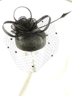 Black sinamay pillbox with pitted netting