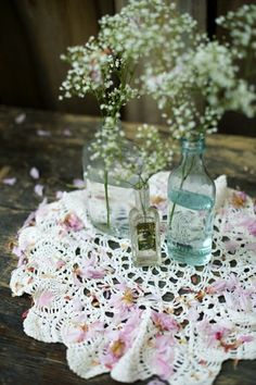In your antique amethyst bottles....Wedding Flowers: Baby's Breath | Intimate Weddings - Small Wedding Blog - DIY Wedding Ideas for Small and Intimate Weddings - Real Small Weddings