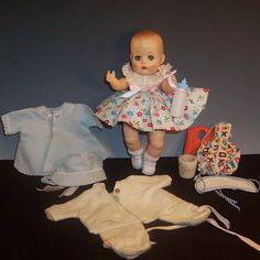 1950'S VOGUE Ginnette Baby Doll; Tagged Dress, Coat Bonnet, PJ's & : Ruth's Redemptions Antiques & Collectibles | Ruby Lane Small Baby Dolls, Blue Coats, Little White, Pastel Blue, Ruby Lane, Swim Trunks, Vintage Dolls, Pjs, Fashion Shoes
