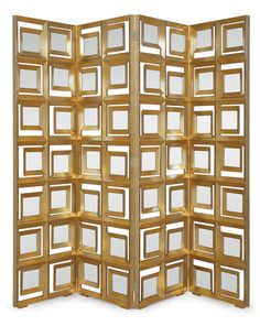 modernist screen with up to fiftysix mirror panes intricately fitted into solid mahogany frames creating a design that is bold and beautiful