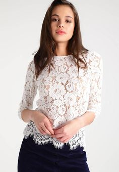 "Blouse - snow white. Sheer:very sheer. Fabric:Lace. Details:zip fastening. Neckline:round neck. Sleeve length:long,21.0 "" (Size 10). Our model's height:Our model is 69.5 "" tall and is wearing size 10. Outer fabric material:75% cotton, 25% nylon. Total length:22.0 "" (S..."
