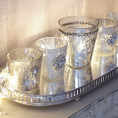 mercury votives. get some small glasses at goodwill and use krylon paint. (see crafts for tips)
