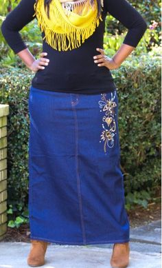 Corie is a plus size straight denim maxi skirt with side embroidery and is available in sizes 12-22