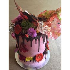 Handcrafted toffee, fresh flowers and a seven tier stack of vanilla birthday cake with chocolate Nutella ganache. ❤️