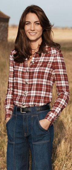 The Duchess of Cambridge poses for British VOGUE wearing a plaid Burberry shirt with 7 For All Mankind Belted Palazzo Rinse Jeans and a black belt.