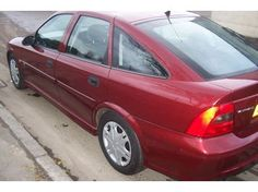 Almost the last of my Vauxhall cars I had this time a red 1.8 Vauxhall Vectra like this.