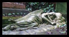 Angel asleep on a stone pillow -- Highgate Cemetery, London, England
