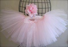 Light Pink Tutu with Flower. Pastel Pink Tutu. Elegant Tutu. First Birthday Tutu. Flower girl Tutu. New baby girl tutu.. $27.99, via Etsy.