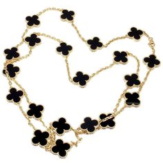 Van Cleef  Arpels Vintage Alhambra Yellow Gold 20 Motif Onyx Necklace | From a unique collection of vintage link necklaces at http://www.1stdibs.com/jewelry/necklaces/link-necklaces/