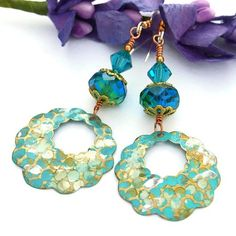 The CALL OF THE CARIBBEAN handmade earrings are lovely, eye catching dangles - and are aptly named because of their turquoise / capri blue color so reminiscent of the tropical waters of the Caribbean. @shadowdog