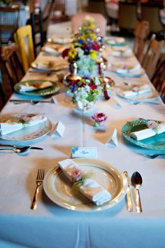 Cute shabby chic table decor - love the non-matching plates