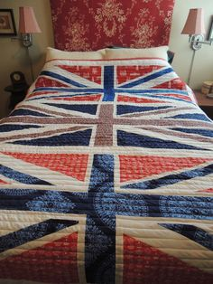 3 Union Jacks instead of one big one or bunches of little ones... Depending on the dimensions of the quilt... I kind of like this.