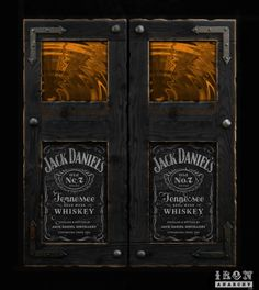 Jack Daniel's Whiskey saloon door concept by IronAnarchy.com using aged signage, whiskey-colored rippled art glass, and wrought iron accents.