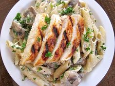 Grilled Chicken over Creamy Mushroom Pasta. This creamy mushroom pasta is a restaurant favorite that's surprisingly easy to make at home. Chicken Mushroom Pasta, Creamy Mushroom Pasta, Mushroom Sauce, Mushroom Recipes, Mushroom Alfredo, Chicken Mushrooms, Garlic Mushrooms, Creamy Pasta, Chicken Alfredo
