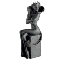 ROYAL COPENHAGEN  Leo - black  Over the course of a year, the Sun passes all the constellations of the Zodiac to complete The Circle of Life.  The female zodiac is both sensual and innocent. Designed by the Danish artist Christel Marrot, the figurines convey vibrancy and beauty in unglazed inky black or velvety white porcelain.