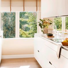 Antes y después de una reforma que unió cocina y salón House, Windows