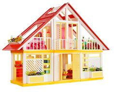 A Look Back at Barbie's Dreamhouse - GoodHousekeeping.com