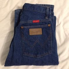 Vintage Wrangler High Waisted Jeans Mom Pants Dark A pair of vintage iconic wrangler patch mom jeans. High waisted, dark wash. Waist 25, length 34. Same as urban renewal jeans! (except you get exact size instead of a random pair) Made for someone taller than 5ft but you could cut them if you're super short🔥$30 on merc🔥 Open to offers!!! ✅ Urban Outfitters Jeans Boyfriend
