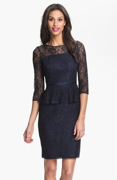 Lustrous lace covers an elegant sheath dress flatteringly shaped with a gentle peplum waist and a slim, above-the-knee skirt. A sheer yoke and three-quarter sleeves keep the look light and lovely.