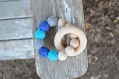 http://www.etsy.com/listing/124607584/wood-crochet-teething-toy
