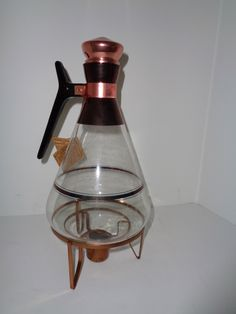 A personal favorite from my Etsy shop https://www.etsy.com/listing/242636559/vintage-inland-glass-coffee-carafe-with
