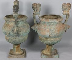 """Large cast-iron neoclassical verdigris urns, 37"""" high (as side tables with mercury-glass inset)"""