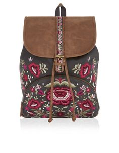 Bring a bohemian influence to your look with our Carolina backpack, decorated with folkloric floral embroidery. This embellished piece has a faux leather top with a tab and buckle detail, plus a front zipped pocket. Adjust the shoulder straps for a customisable fit.