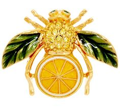 With a twist. A citrus slice lends refreshing distinction to this goldtone bee pin from Joan Rivers. Crystals sparkle along the body, while leaf wings lend a unique finishing touch. From the Joan Rivers Classics Collection(R).<br><br>Lemon or Lime. QVC.com