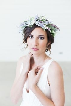 This gorgeous and elegant lavender floral hair crown is accented with a lovely and realistic selection of flowers and foliage to create a gorgeous look that is