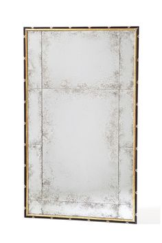 Manoir Mirror by Ebanista - Hand carved mirror. Ebonized frame with 22k gold and 12k white gold detailing. Segmented antiqued mirror. Discover more at https://www.ebanista.com.