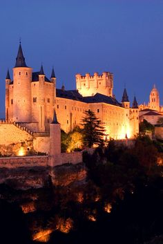 Alcazar of Segovia, Spain The Alcazar of Segovia is rising out on a rocky crag above the confluence of two rivers. It is one of the most distinctive castle-palaces in Spain by virtue of its shape - like the bow of a ship.
