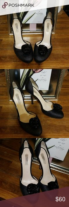 PRADA BLACK ROSE PUMPS SIZE 37.5 Worn for a few photo shoots  ...small  tiny Nick on one heel see pic  not really noticeably seen . PLEASE BE AWARE OF PRADA SIZING..IT WILL NOT BE MY FAULT IF YOU CAN  NOT FIT THIS SHOE ... Prada Shoes Heels