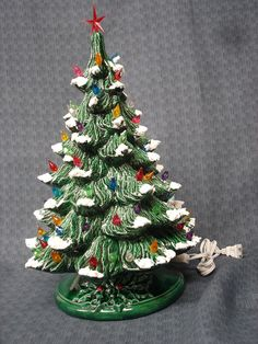 Large Ceramic Green Glazed Christmas Light up Tree with Multi-colored Lights. $45.00, via Etsy.