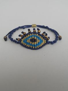 Hey, I found this really awesome Etsy listing at https://www.etsy.com/listing/232118952/macrame-evil-eye-bracelet-with-beaded