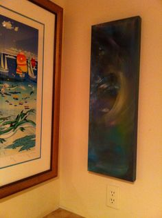 It corresponds with the other painting in the room, to the left. Hard wall to fit.